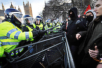 Police keep protestors behind barriers to prevent them getting to the Houses of Parliament on Parliament Square during a student demonstration in Westminster, central London on the day the government passed a bill to increase university tuition fees.