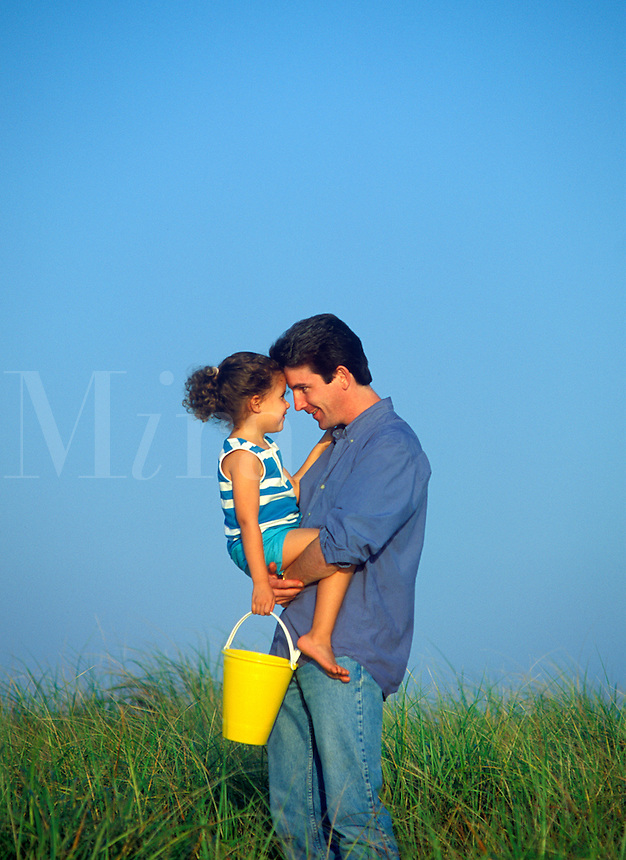Affectionate father and daughter at the beach. Cape Cod