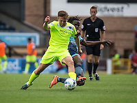 Marcus Bean of Wycombe Wanderers tackles Tom Lapslie of Colchester United during the Sky Bet League 2 match between Wycombe Wanderers and Colchester United at Adams Park, High Wycombe, England on 27 August 2016. Photo by Liam McAvoy.