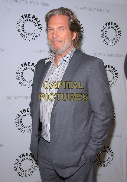 "JEFF BRIDGES.The Paley Center For Media Presents ""American Masters - Jeff Bridges: The Dude Abides""   held The Paley Center for Media, Los Angeles, USA, .8th January 2011..half length beard facial hair grey gray suit hands in pockets striped shirt .CAP/ADM/TC.©T. Conrad/AdMedia/Capital Pictures."