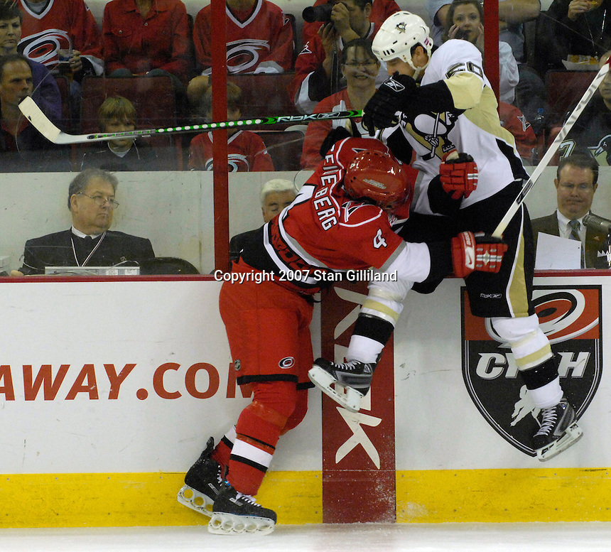 Carolina Hurricanes' Dennis Seidenberg checks the Pittsburgh Penguins' Colby Armstrong during their game Friday, Oct. 5, 2007 in Raleigh, N.C. The Hurricanes won 4-1.
