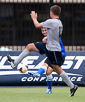 Josh Turnley (11) of Georgetown tries to stop the cross of Vincent Keller (4) of Creighton during the game at Shaw Field on the campus of the Georgetown University in Washington, DC.  Georgetown tied Creighton, 0-0, in double overtime.