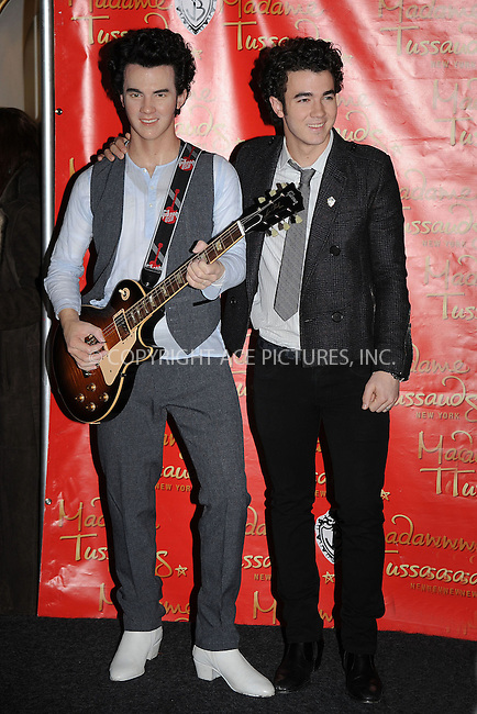 WWW.ACEPIXS.COM . . . . . ....February 12 2009, New York City....Kevin Jonas poses with his wax figure at Madame Tussauds on February 12, 2009 in New York City.....Please byline: KRISTIN CALLAHAN - ACEPIXS.COM.. . . . . . ..Ace Pictures, Inc:  ..tel: (212) 243 8787 or (646) 769 0430..e-mail: info@acepixs.com..web: http://www.acepixs.com
