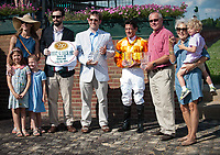 WILMINGTON, DE - JULY 8: The connections of Guilty Twelve #6 collect the trophy after winning the G3 Robert Dick Memorial at Delaware Park in Wilmington, Delaware. (Photo by Sophie Shore/Eclipse Sportswire/Getty Images)