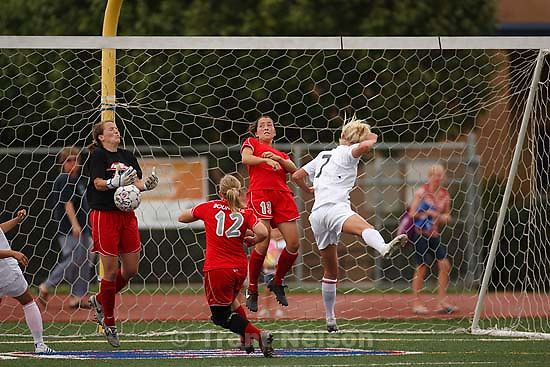 Bountiful's goalkeeper Amy Clark, Brittney Sevy (12), and Felicia Sturgeon (13) keep the ball out of the net as Woods Cross' Kendra Pemberton (7, right) attacks the goal. Woods Cross - Woods Cross vs. Bountiful high school girls soccer Tuesday, September 9, 2008 at Woods Cross.