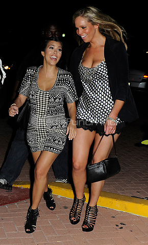 MIAMI BEACH, FL -  MARCH 26:  Kim Kardashian single and having fun in Miami Beach.  Kim Kardashian looking happy and single. Kim and sister Kourtney Kardashian were joined by publicist not-so-extraordinaire Jonathan Cheban at dinner . On March 26, 2010 in Miami Beach, Florida<br /> <br /> <br /> People:  Kim Kardashian_Kourtney Kardashian_Jonathan Cheban<br /> <br /> Transmission Ref:  MNC4<br /> <br /> Hoo-Me.com / MediaPunch