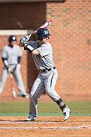 Tripp Shelton (16) of the UNCG Spartans at bat against the High Point Panthers at Willard Stadium on February 14, 2015 in High Point, North Carolina.  The Panthers defeated the Spartans 12-2.  (Brian Westerholt/Four Seam Images)