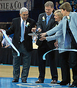 Several university and state officials, including North Carolina Governor Bev Purdue, cut the ribbon for the dedication of the newly renovated Carmichael Arena. (Photo by Rob Rowe)