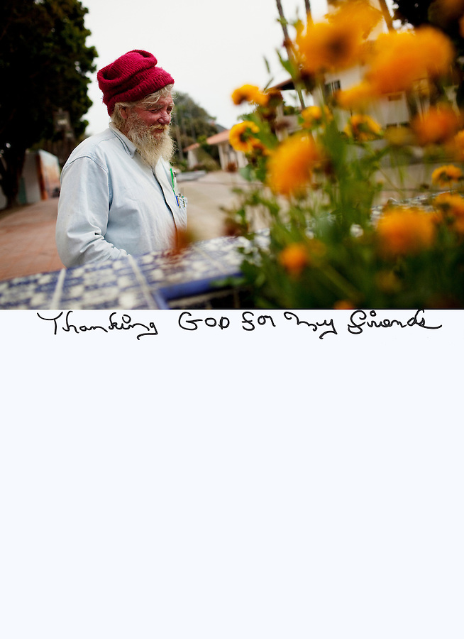 "This is a scan of a print that was given to the subject, Mike Vance, so that he could write his thoughts. He tersely described what was on his mind by saying:..""Thanking GOD for my friends""..Ventura, California, July 20, 2010 - A portrait Mike Vance where he spends a lot of his time, Mission Park next to the Knights of Columbus Hall. Mr. Vance has been homeless roughly since 1966, when he says he was crushed by a tree that left him unable to hold a steady job. He survives from small SSI checks and the kindness of the local Knights of Columbus Hall that allows him to sleep on their steps and occasionally feeds him. Mr. Vance likes to read and is often seen on these benches and in the neighboring park reading magazines and books people leave behind. Because of the public rest rooms in Mission Park as well as its proximity to the River it is a popular spot for the homeless in Ventura. ."