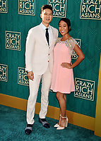 HOLLYWOOD, CA - AUGUST 07: Harry Shum Jr. (L) and Shelby Rabara arrive at the Warner Bros. Pictures' 'Crazy Rich Asians' premiere at the TCL Chinese Theatre IMAX on August 7, 2018 in Hollywood, California.<br /> CAP/ROT/TM<br /> &copy;TM/ROT/Capital Pictures