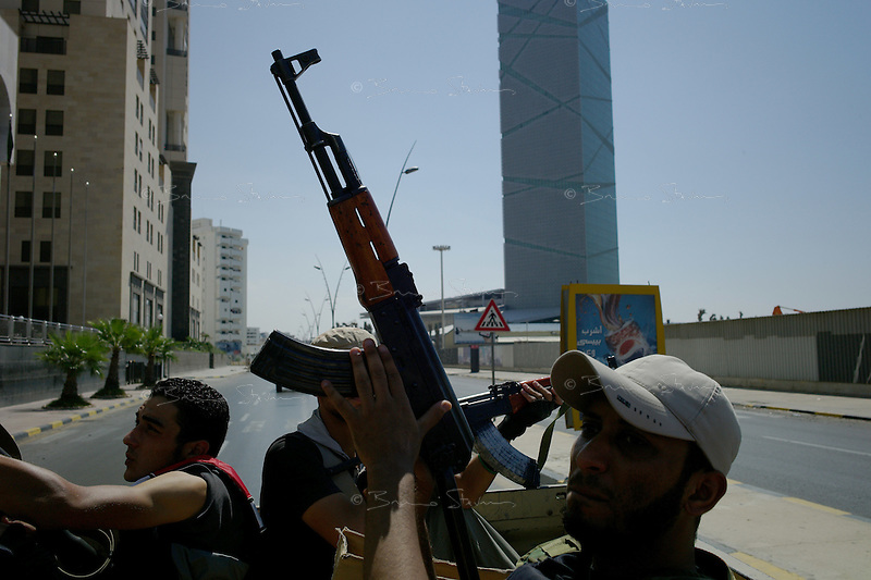 Tripoli, Libya, August 24, 2011.A group of Rebels patrol the streets of downtown Tripoli searching for rooftop snipers and pockets of resistance...