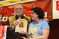 Greg Bill is honored with the Herbie Nayokpuk spirit of the Iditarod award as he retires after his 42 years of working with the Iditarod at the musher 's finishers banquet in Nome.  His wife Annie at his side. Sunday March 16 after the 2014 Iditarod Sled Dog Race.<br /> <br /> PHOTO (c) BY JEFF SCHULTZ/IditarodPhotos.com -- REPRODUCTION PROHIBITED WITHOUT PERMISSION