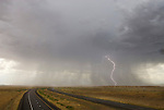 Rain and lightening, thunderstorm, Ranch Exit no. 1 east of Green River, Utah, on I-70