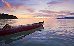 Dugout canoe and fishing net at sunset, Iris Strait, Kaimana area, Papua