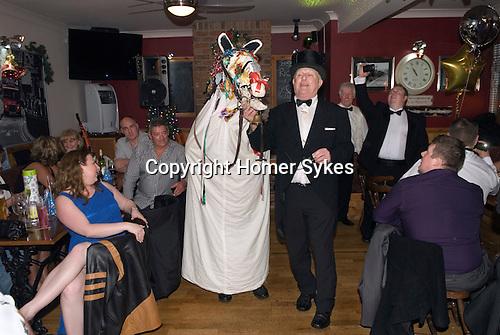 Mari Lwyd, Llangynwyd near Bridgend Glamorgan bringing in the New Year December 31st 2012. Gwyn Evans as Leader or Ostler