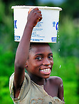 A girl carries a bucket of water on her head in Karonga, a town in northern Malawi.