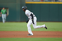 Luis Robert (9) of the Charlotte Knights hustles towards third base against the Gwinnett Braves at BB&T BallPark on July 12, 2019 in Charlotte, North Carolina. The Stripers defeated the Knights 9-3. (Brian Westerholt/Four Seam Images)