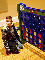 Janelle Jessen/Herald-Leader <br /> Marcus Polina Jr. played a giant game of Connect Four.