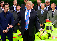United States President Donald J. Trump answers questions from the media as he greets the 103rd Indianapolis 500 Champions: Team Penske, on the South Lawn of the White House in Washington, DC on Monday, June 10, 2019.  The President took some questions on trade, Mexico, and tariffs against China.<br /> Credit: Ron Sachs / CNP/AdMedia