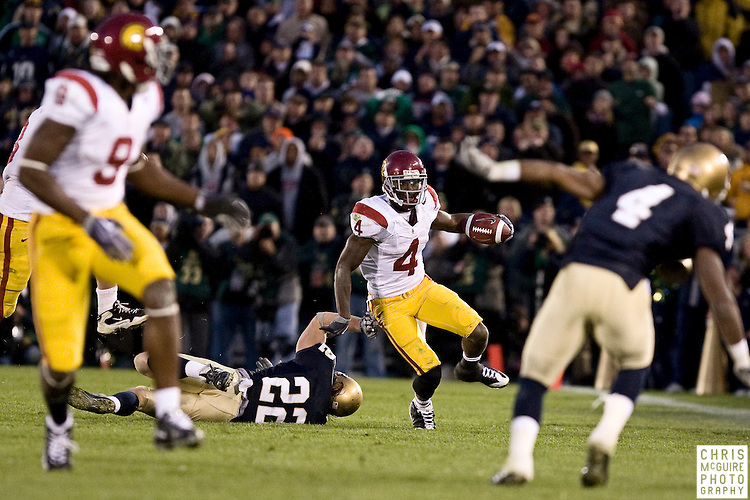 10/17/09 - South Bend, IN:  USC running back Joe McKnight evades a tackler during their game at Notre Dame Stadium on Saturday.  USC won the game 34-27 to extend its win streak over Notre Dame to 8 games.  Photo by Christopher McGuire.