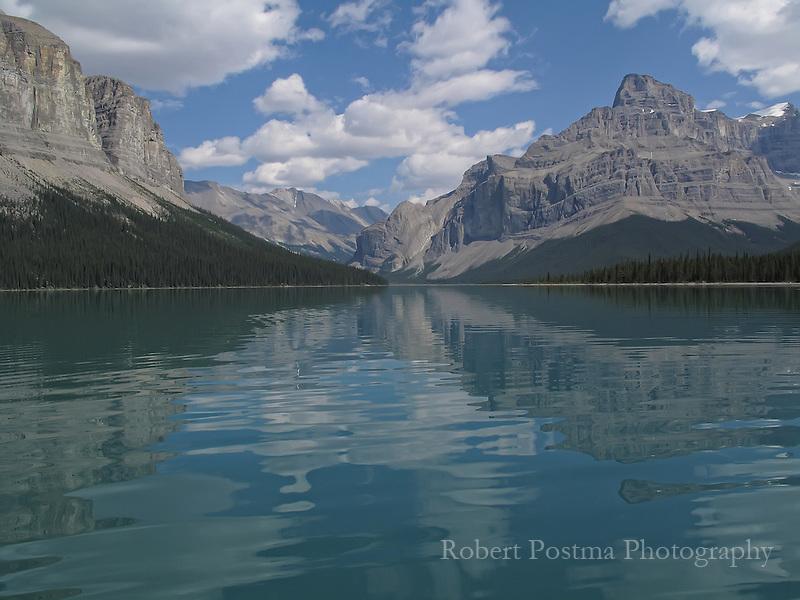 Mountains reflected into Maligne Lake, Alberta.
