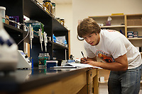 Biology major Adam Kantor '10 works on a research project in the BioScience Building, Oct. 14, 2009. (Photo by Marc Campos, Occidental College)