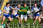 Kerry Darran O'Sullivan tries to get away from Shane Carey Monaghan  during their NFL clash in Fitzgerald Stadium on Sunday