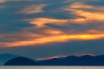 A sunset blazes over Howe Sound north of the city of Vancouver British Columbia, Canada.  Photo by Gus Curtis.