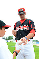 Batavia Muckdogs outfielder Austin Dean (3) signs autographs before a game against the Hudson Valley Renegades on August 8, 2013 at Dwyer Stadium in Batavia, New York.  The game was cancelled in the third inning with Batavia leading 1-0 due to rain storms.  (Mike Janes/Four Seam Images)