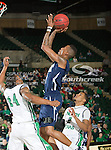 Jackson State Tigers guard Jenirro Bush (1) and North Texas Mean Green guard Trey Norris (14) in action during the game between the Jackson State Tigers and the University of North Texas Mean Green at the North Texas Coliseum,the Super Pit, in Denton, Texas. UNT defeated Jackson State 69 to 55...