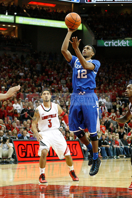 UK guard Ryan Harrow (12) jumps to shoot the ball during the first half of the UK Men's basketball game vs. University of Louisville at KFC Yum! Center in Louisville, Ky., on Saturday, December 29, 2012. U of L won 80-77. Photo by Tessa Lighty | Staff