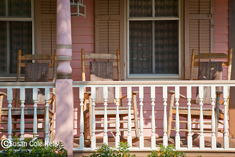 Rocking chairs on a Victorian cottage porch in Cape May, NJ, USA