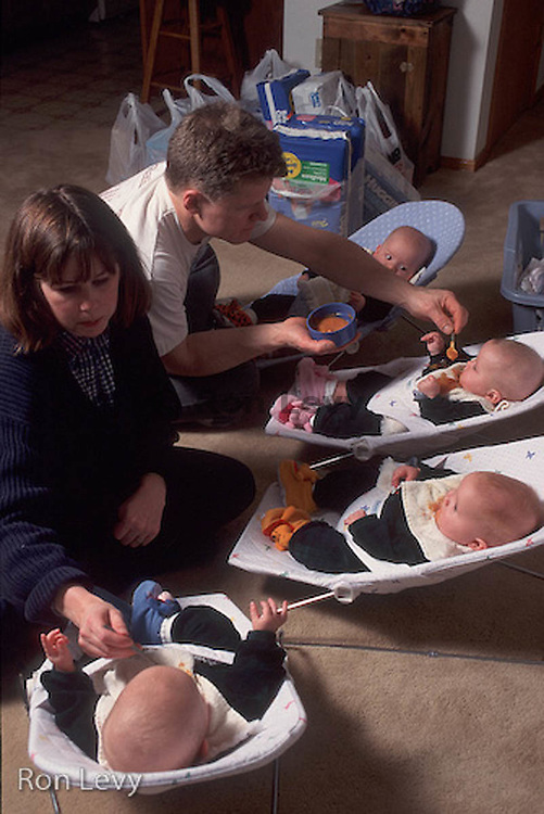 Parents feeding quadruplets, Wasilla, Alaska