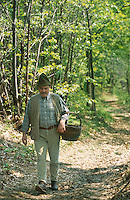 Josko Sirk walking in the woods around his Kozolec inspired house. Kozolecs were traditional Slovenian barns used for drying hay