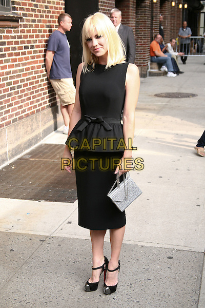 Anna Faris .At the Ed Sullivan Theater for an appearance on the 'Late Show with David Letterman', New York, NY, USA..27th September, 2011.full length black sleeveless dress peplum ankle strap shoes silver purse bag.CAP/LNC/TOM.©LNC/Capital Pictures.