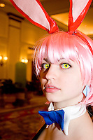 "Melanie McShane, cos-playing as Haruko Haru Haru, at the 12th annual Katsucon, a convention for fans of Japanese comics (manga), animation (anime), and video games, held in Washington D.C. on February 18, 2006 and attended by over 8,000 people.<br /> <br /> Cosplay, short for ""costume play"", is the act of creating and wearing outfits of one's favorite anime, comic, or video game and often acting out that characters actions."