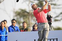 Graeme McDowell (NIR) tees off the 16th tee during Sunday's Final Round of the 2014 BMW Masters held at Lake Malaren, Shanghai, China. 2nd November 2014.<br /> Picture: Eoin Clarke www.golffile.ie