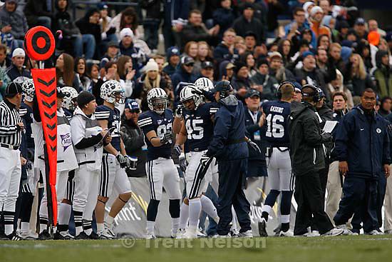 BYU head coach Bronco Mendenhall congratulates BYU's Harvey Unga (45) after he became the leading career rusher in BYU history. BYU vs. Air Force college football Saturday, November 21 2009.