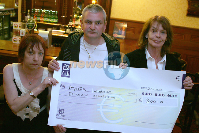 Trish Crerar accepts a cheque from June Bolger and Brendan Woods on behalf of the Motor Neuron Association...Photo NEWSFILE/Jenny Matthews.(Photo credit should read Jenny Matthews/NEWSFILE)....This Picture has been sent you under the condtions enclosed by:.Newsfile Ltd..The Studio,.Millmount Abbey,.Drogheda,.Co Meath..Ireland..Tel: +353(0)41-9871240.Fax: +353(0)41-9871260.GSM: +353(0)86-2500958.email: pictures@newsfile.ie.www.newsfile.ie.FTP: 193.120.102.198.