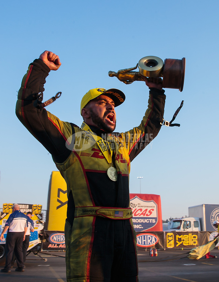 Nov 11, 2018; Pomona, CA, USA; NHRA funny car driver J.R. Todd celebrates after winning the Auto Club Finals at Auto Club Raceway. Mandatory Credit: Mark J. Rebilas-USA TODAY Sports