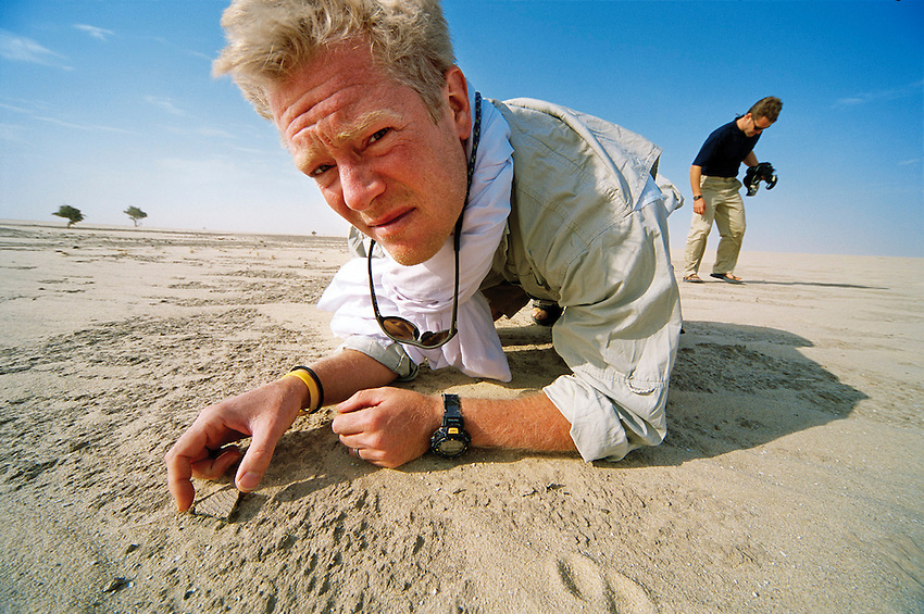 Geneticist Dr. Spencer Wells, examines ancient pottery shards while on expedition in the Sahara desert, Chad, for National Geographic Genographic Project