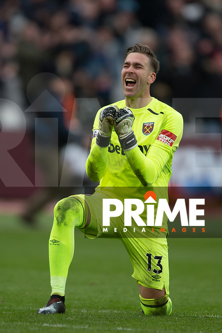 Goalkeeper Adrian of West Ham United celebrates his teams victory at full time during the Premier League match between West Ham United and Chelsea at the Olympic Park, London, England on 9 December 2017. Photo by Andy Rowland.