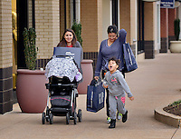 STAFF PHOTO BEN GOFF  @NWABenGoff -- 12/03/14 Brittany Harper, from left, pushes her infant daughter Scarlett Harper while shopping with her mother Stella Peterson and sister Mattea Peterson, 4, at Pinnacle Hills Promenade in Rogers on Wednesday Dec. 3, 2014.