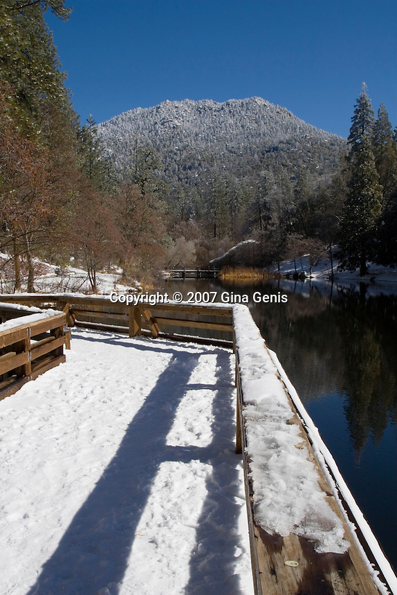 Snow covered pier at Lake Fulmor in Southern California