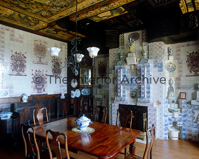 The walls of Victor Hugo's dining room have been decorated with a variety of coloured ceramic tiles