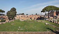 Open square of the 3rd century Tempio Rotondo (Round Temple) with Casseggiato del Larario (House of the Lararium), 1st century AD, in the background, Ostia Antica, Italy. Picture by Manuel Cohen