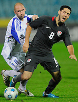 Clint Dempsey (8) tries to maintain possession against Robert Vittek (11). Slovakia defeated the US Men's National Team 1-0 at the Tehelne Pole in Bratislava, Slovakia on November 14th, 2009.