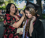 Graduate Tatiana Smith gets help pinning her cap from mom Angela during the University of Nevada College of Liberal Arts and Donald W. Reynolds School of Journalism graduation ceremony on Saturday morning, May 20, 2017.