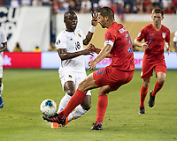 KANSAS CITY, KS - JUNE 26: Abdiel Arroyo #18 attacks against Omar Gonzalez #3 during a game between Panama and USMNT at Children's Mercy Park on June 26, 2019 in Kansas City, Kansas.