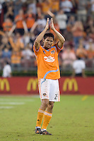 Houston Dynamo forward Brian Ching (25) applauds the crowd as he leaves the field.  Houston Dynamo defeated FC Dallas 4-1 at Robertson Stadium in Houston, TX on November 2, 2007.  Houston Dynamo won the Western Conference semifinal series with an aggregate score of 4-2.